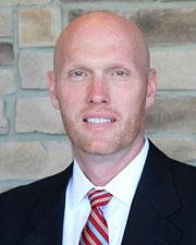 Mitchell E.F. Travis, M.D.